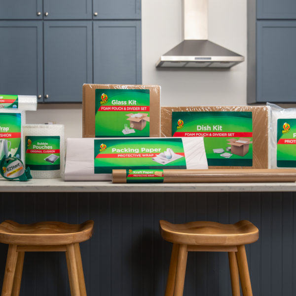 An assortment of packing and shipping products on a kitchen counter.