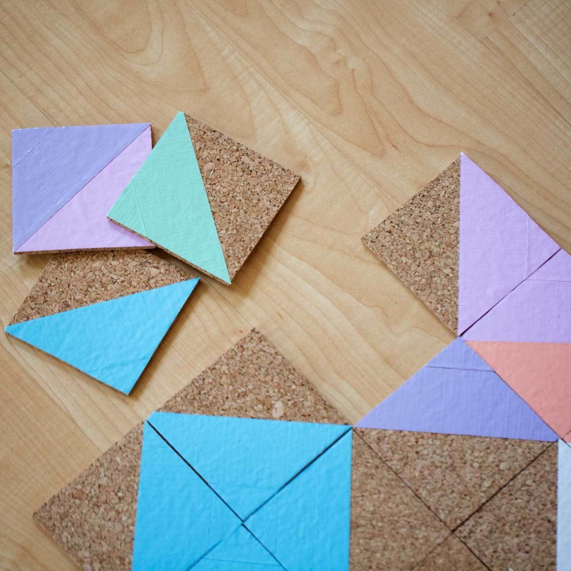 Make a puzzle with cork and Duck Tape