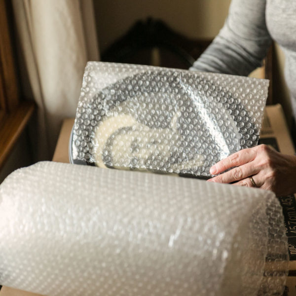 Plates wrapped in bubble wrap.