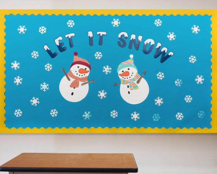A bulletin board with two snowmen