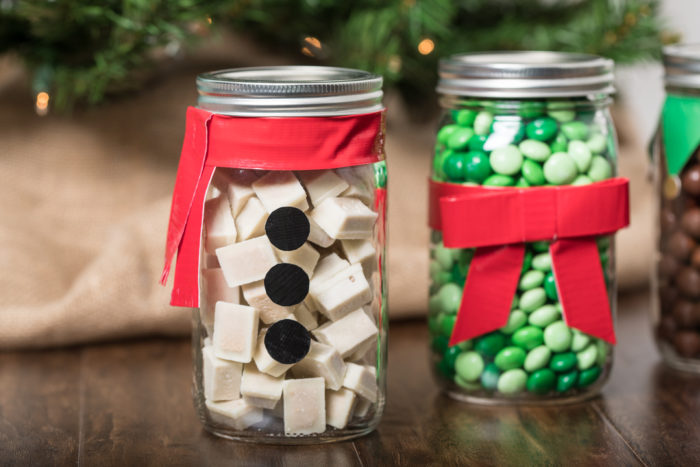 A Snowman decoration made form Duck Tape and a mason jar.
