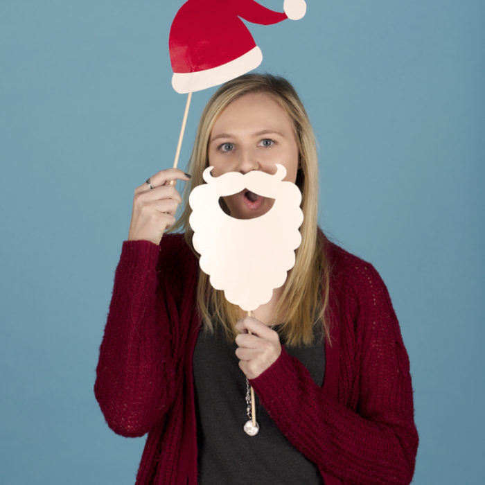 Woman posing with photo booth props of a Santa hat and beard made from Duck Tape