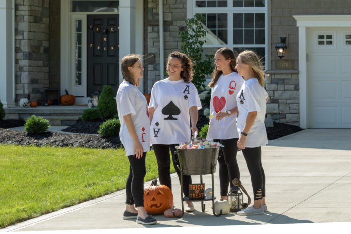 Four children in playing card costumes
