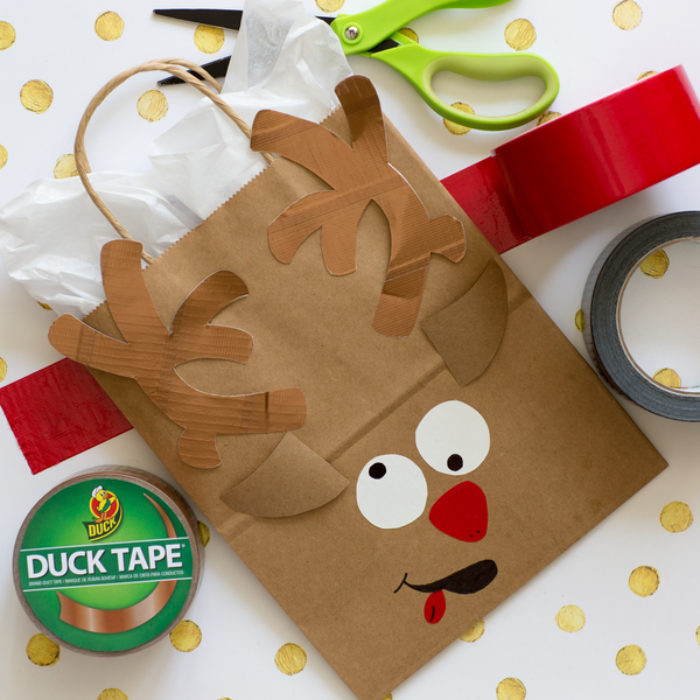 A paper bag decorated as a reindeer.