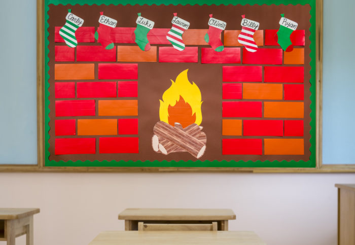 Fireplace bulletin board made from Duck Tape in school room