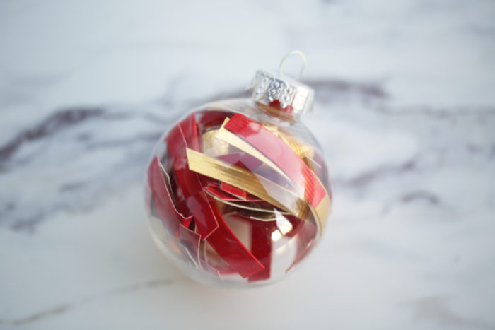 A clear ball ornament filled with Colored Duck tape.