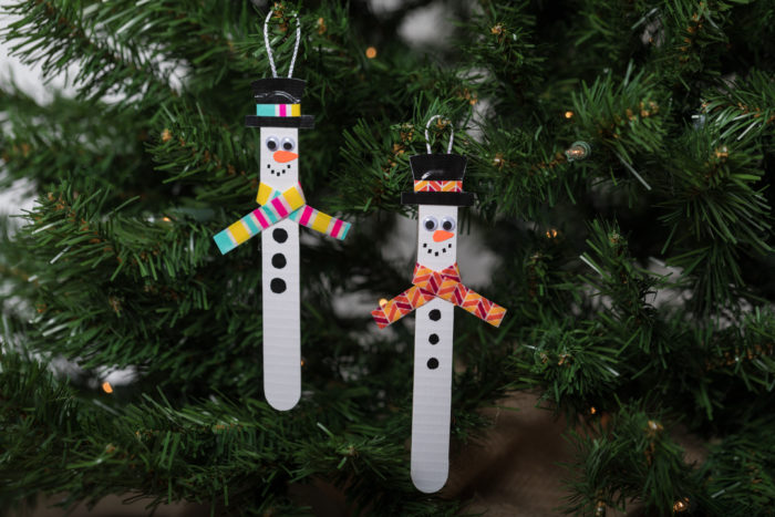 Popsicle stick snow men hanging in a tree.