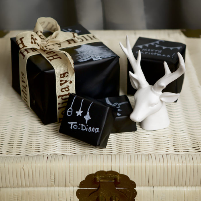 Gifts wrapped in black, chalk board Duck Tape.