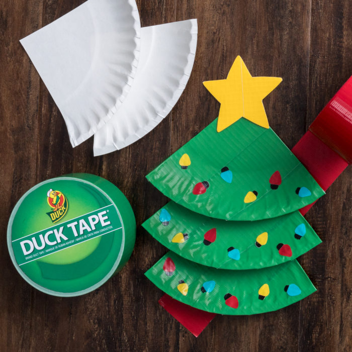 Paper plate Christmas trees next to a roll od Duck tape and white paper plates.