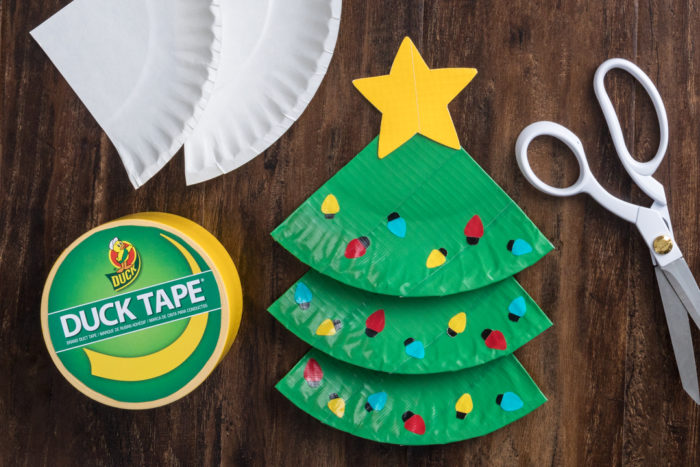 Paper plate Christmas Christmas tree with a yellow star made out of Duck tape.