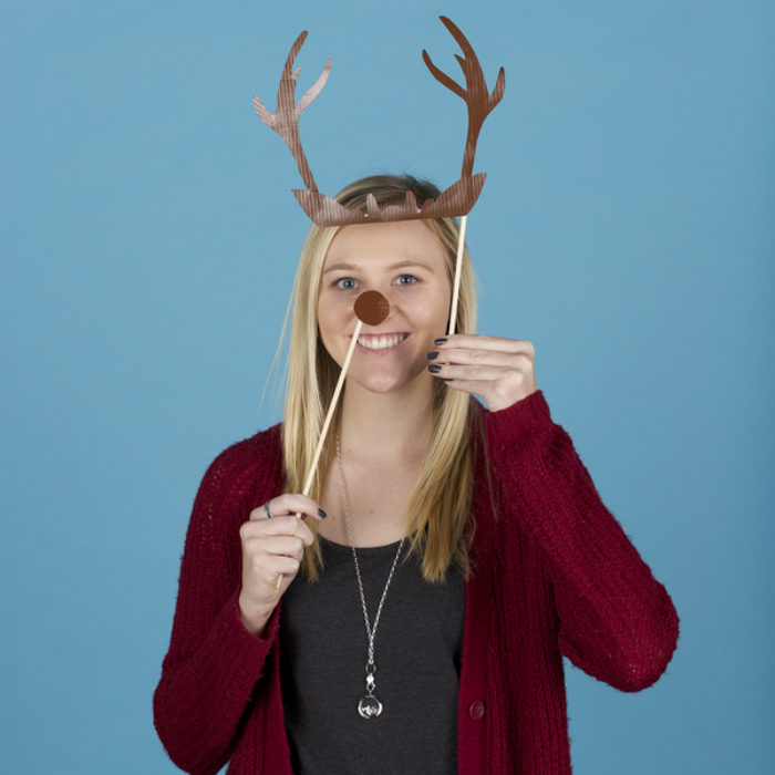 Woman posing with photo booth props made from Duck Tape