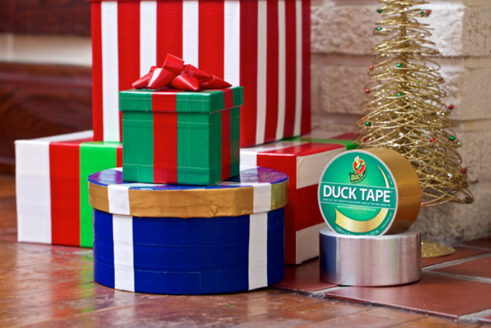 A group of presents wrapped in colored Duck Tape