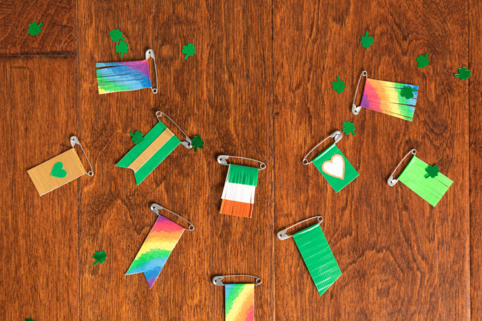 A collection of St. Patrick's Day pins made with colored Duck Tape