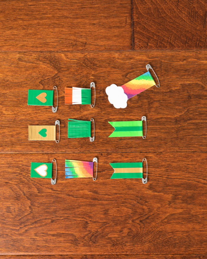 Nine St Patricks Day pins made with colored duck tape