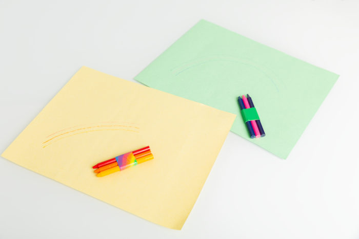 A set of crayons taped together with colored Duck Tape