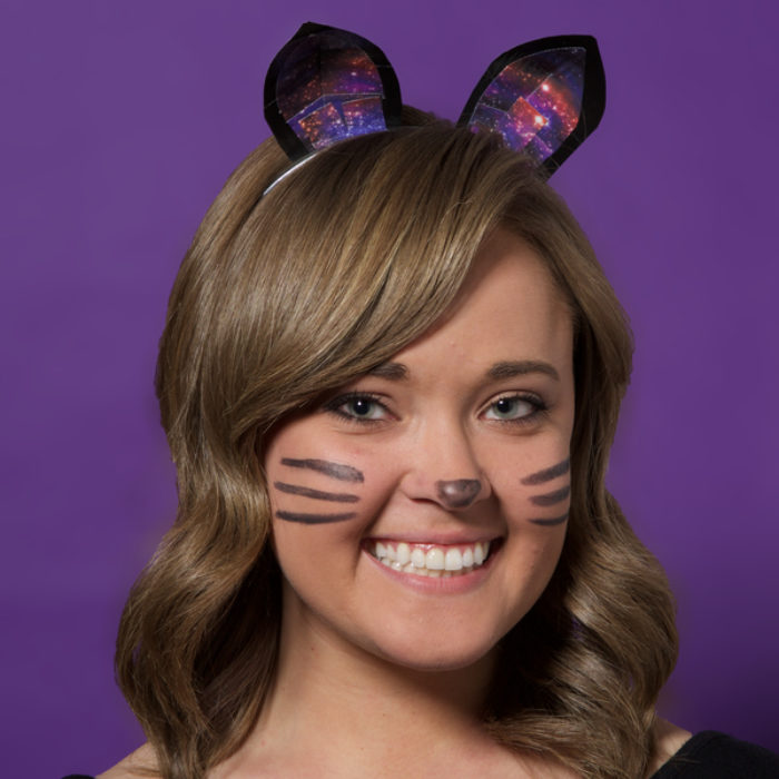 A woman dressed up as a cat and wearing Duck Tape cat ears.