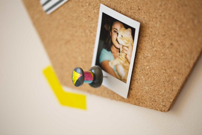 A cork board decorated with washi tape.