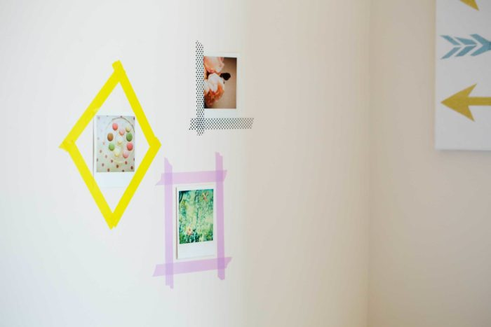 Washi tape framing pictures on a wall.