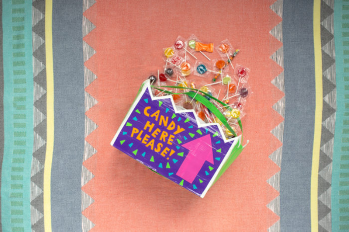 A bag full of candy, decorated with colored duck tape.