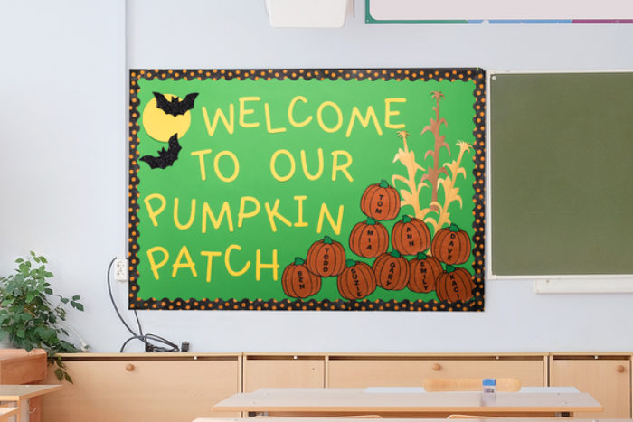 A bulletin board decorated with pumpkins