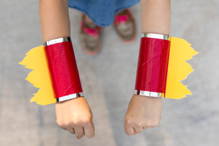 TP wrist cuffs decorated with yellow and red colored duck tape.