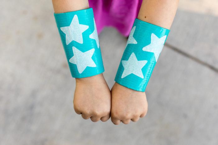 TP wrist cuffs with stars on them.