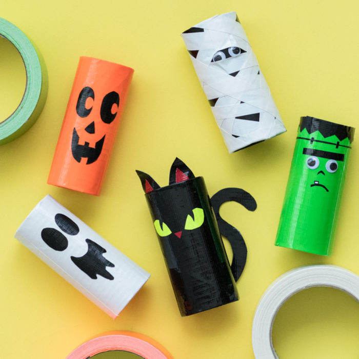 Several TP rolls decorated as different Halloween characters.