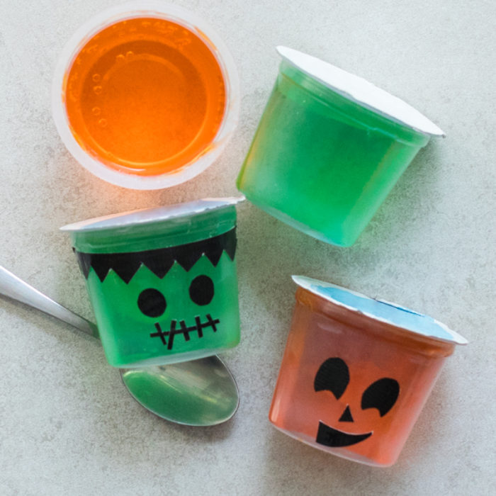 Jell-O cups with Halloween faces on them.
