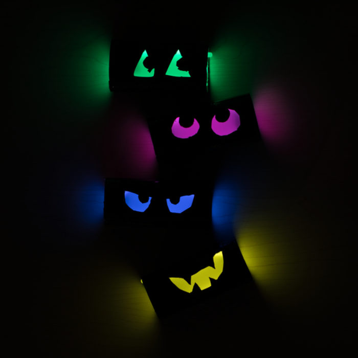TP rolls with cut out eyes that are glowing.