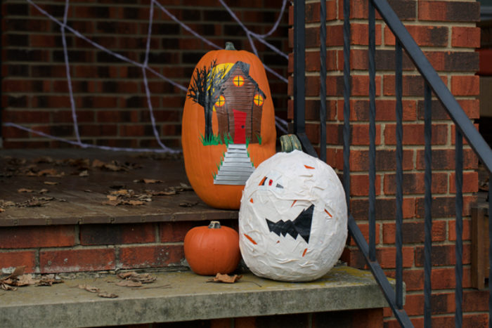 A pumpkin decorated as a mummy with white Duck Tape