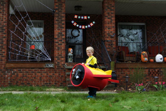A child wearing a plane costume made out of Duck Tape.