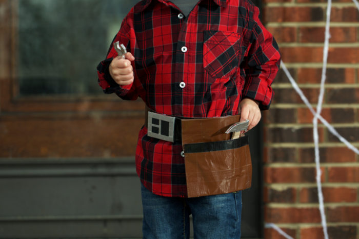 A tool belt made of Duck Tape holding toy tools