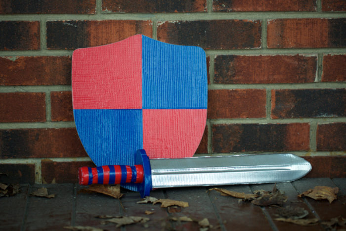 A toy sword and shield made out of Duck Tape.
