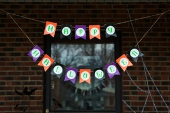 A banner made of Duck Tape that says Happy Halloween