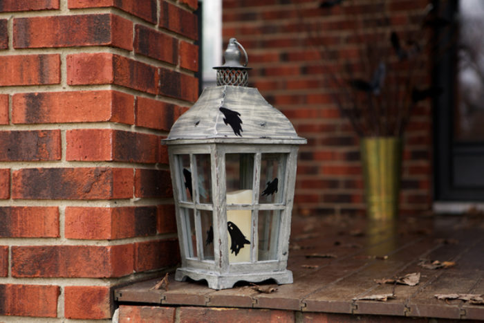 A lantern decorated with black Duck Tape bats.