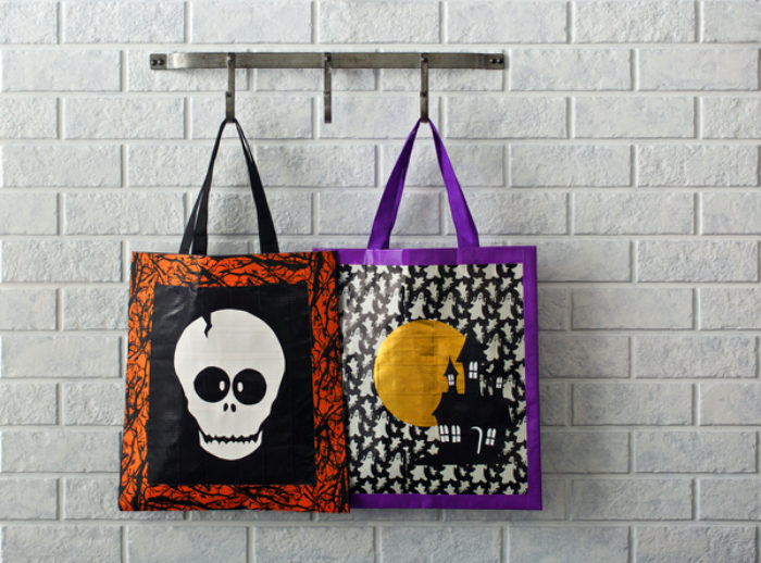 Two Halloween candy bags, decorated with glow in the dark and Colored Duck tape.