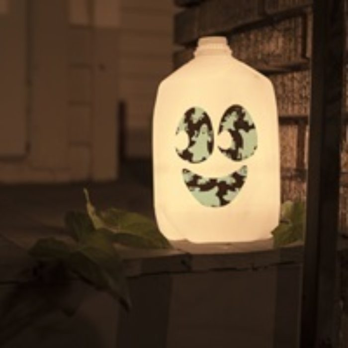 A glow in the dark milk jug with a Duck Tape skull on it.