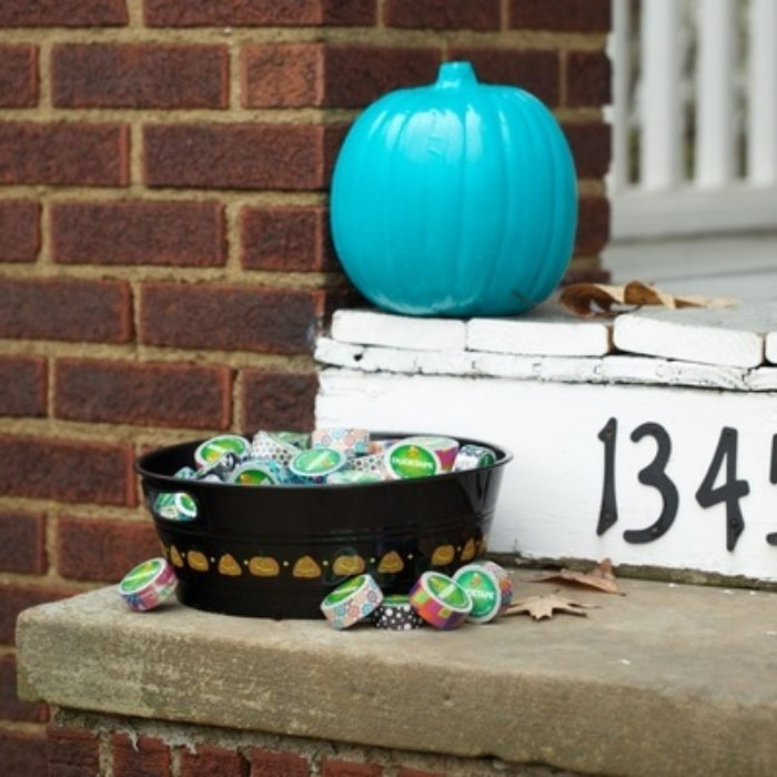 A pumpkin covered with teal Duck Tape.