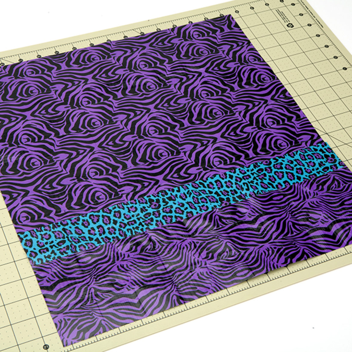 piece from step 3 taped to the bottom of the second piece from step 1