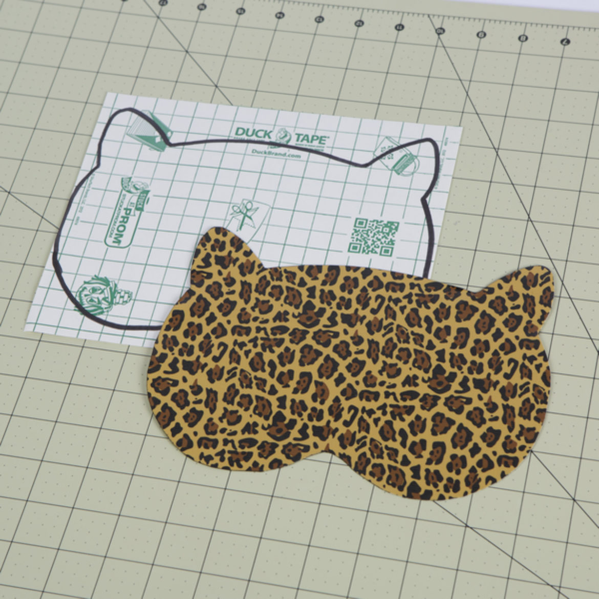 On a Duck Tape sheet, cut out the shape of the animals face