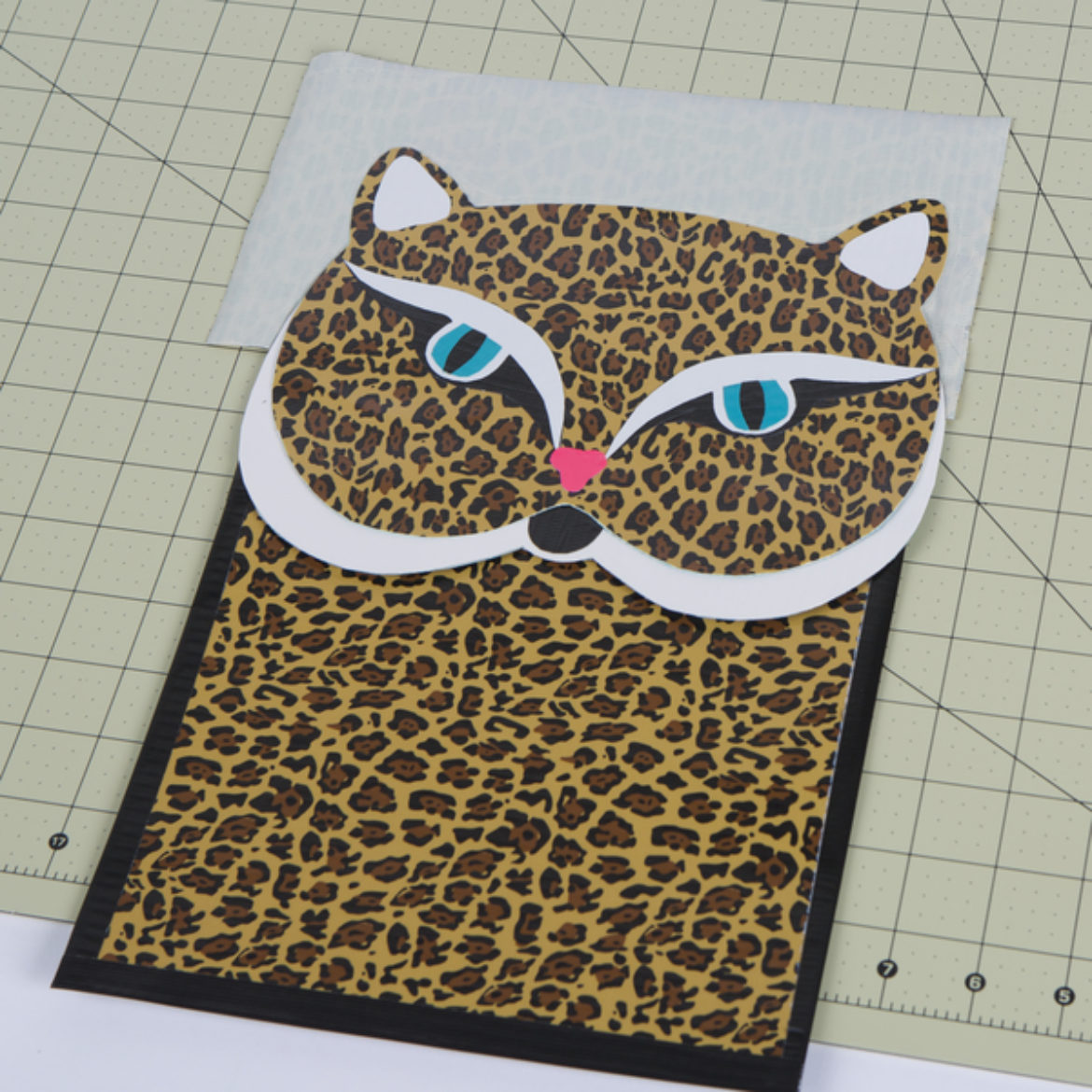 Attach the face to the larger sheet of the pouch with the sticky side that sticks out from the top of the face