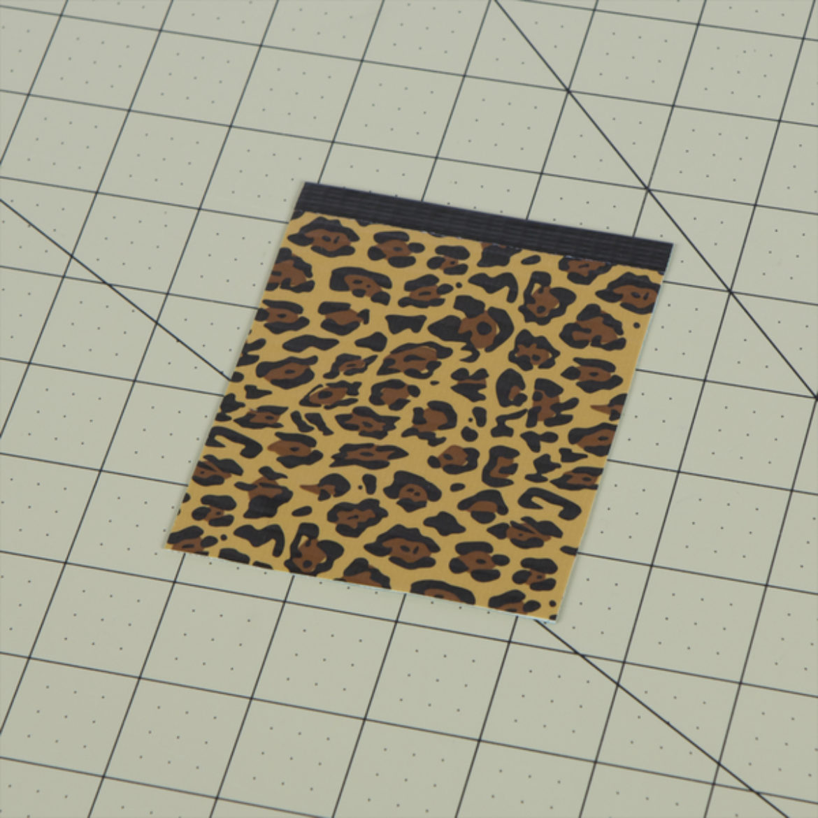 Phone pocket piece from step 4 with a piece of Duck Tape folded over the top to form a border