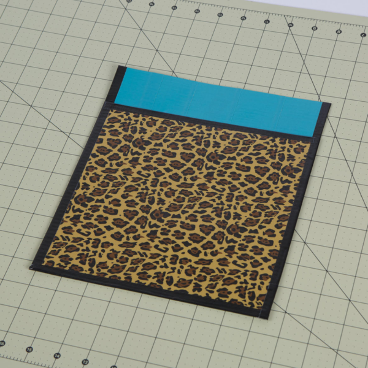 smaller sheet attached to the larger sheet with tape