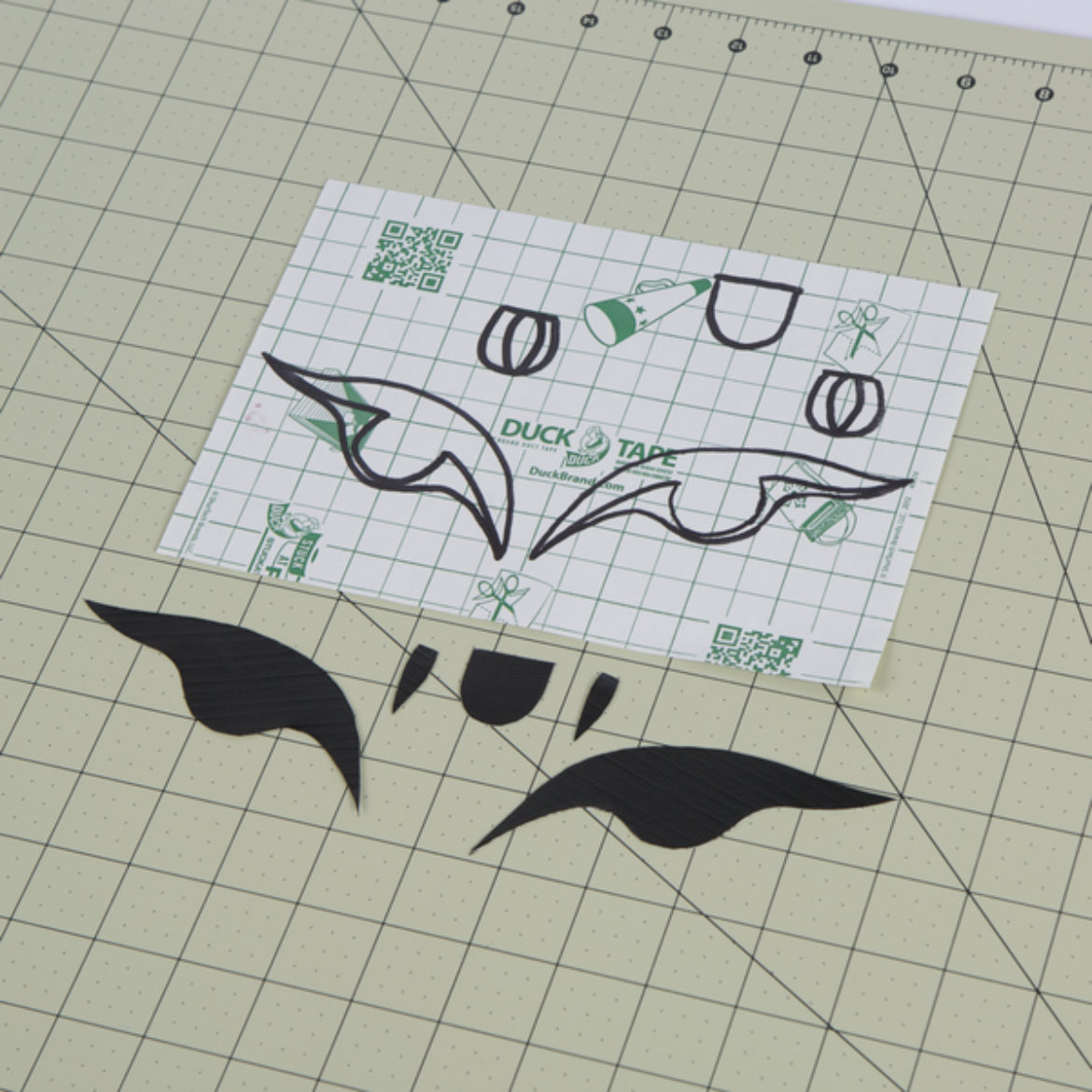 Eyes and tongue outlines cut out of black Duck Tape