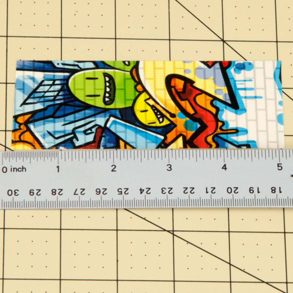 Strip of Duck Tape being measured to ensure that it is 5 inches long
