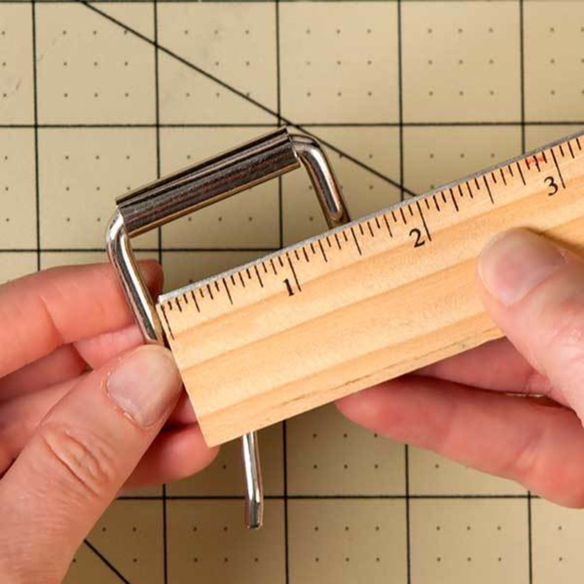 Buckle being measured to ensure that it is 1.5 inches wide