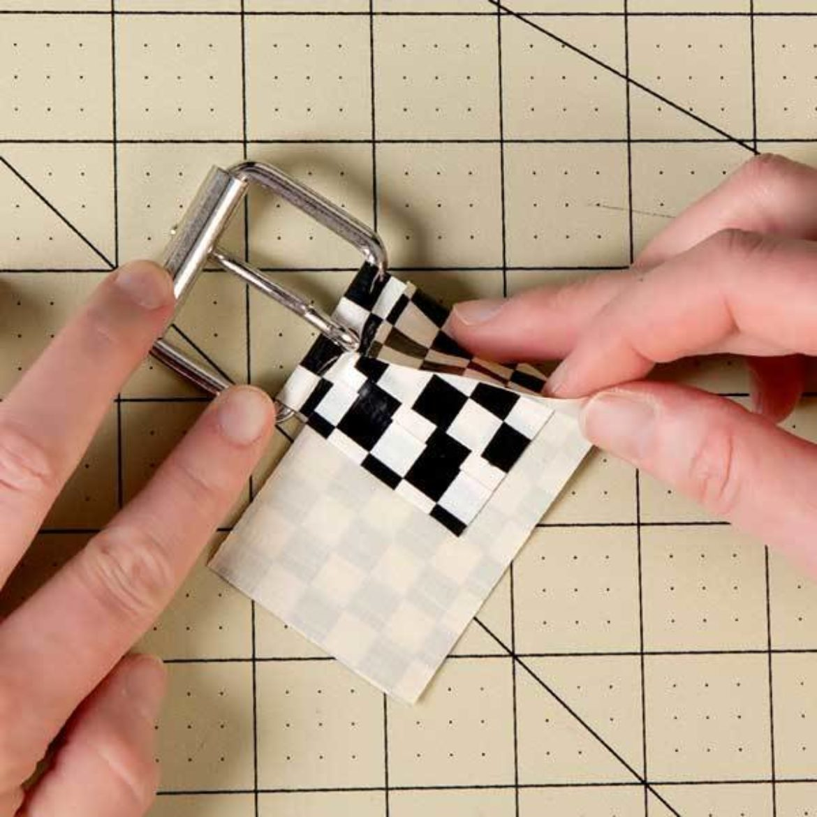 after folding the piece of tape with the slit over itself with the buckle in the middle, secure with a strip of tape