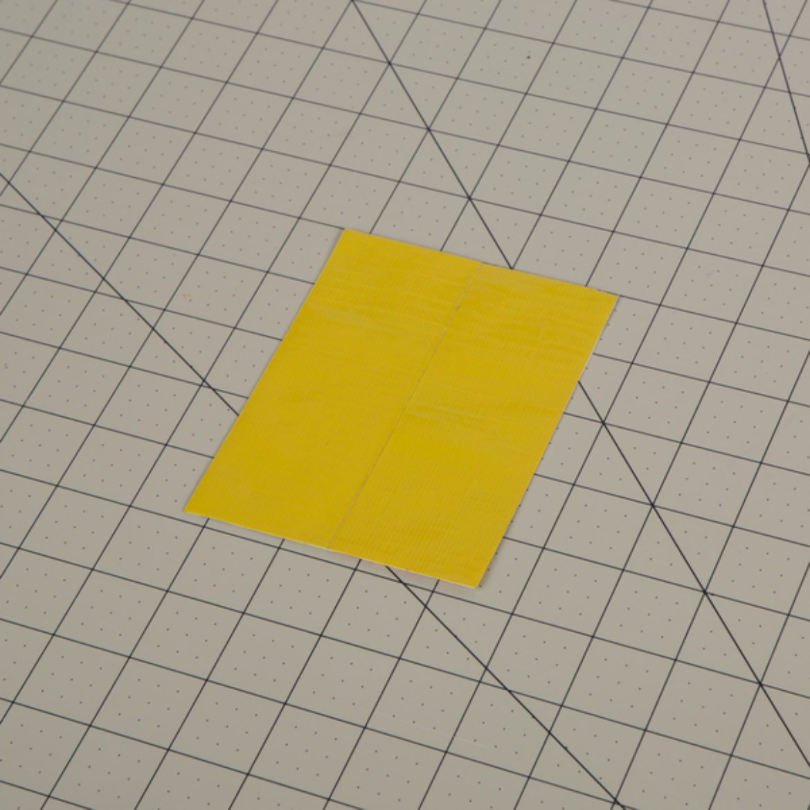 tape placed on the backside of the sheet from the previous step to form a double sided fabric