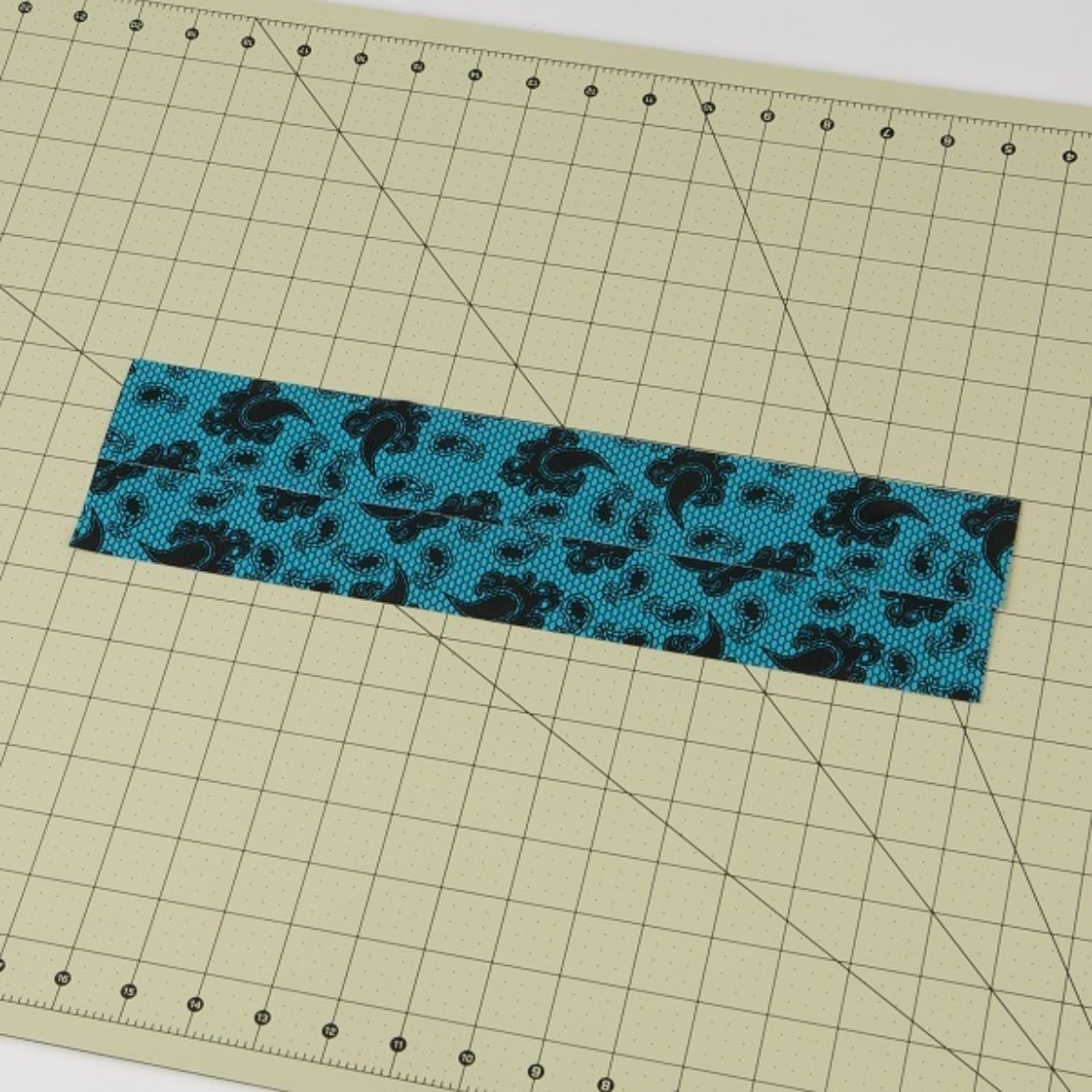Duck Tape fabric made by laying two pieces of overlapped tape over another set of overlapped pieces
