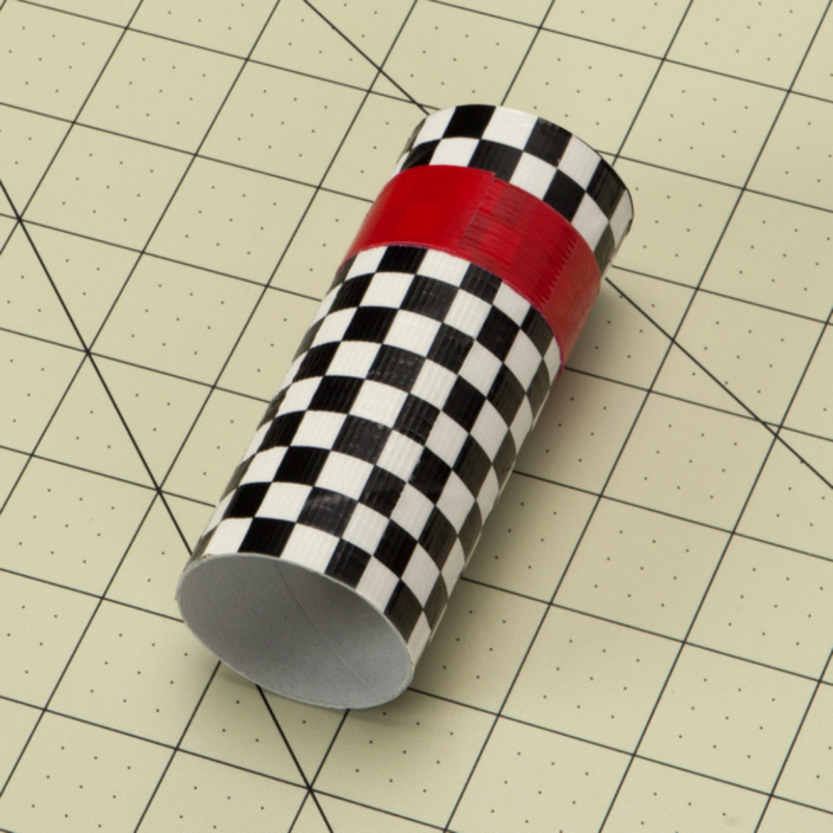 Duck Taped cardboard tube with a red strip added to the top half